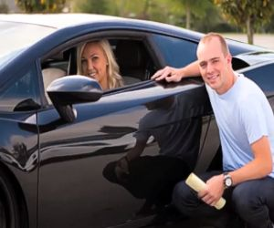 Blonde Woman buying a black car