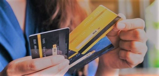 Person holding credit cards